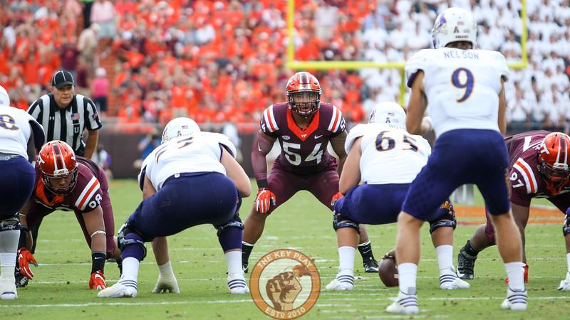 LB Andrew Motuapuaka (54) stares down the ECU quarterback before the snap.  (Mark Umansky/TheKeyPlay.com)