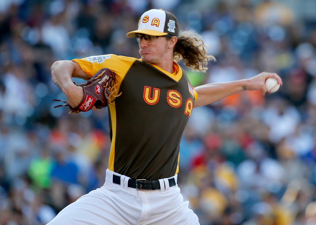 . U.S. Team\'s Josh Hader, of the Milwaukee Brewers, throws during the seventh inning of the All-Star Futures baseball game against the World Team, Sunday, July 10, 2016, in San Diego. (AP Photo/Lenny Ignelzi)