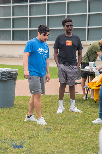 Damian Natividad (left) and Arnold Omwoyo line up to throw some paint.