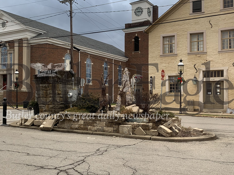"""Photos by Alexandria Mansfield.Some bricks were knocked out of place near the """"Welcome to Harmony"""" sign by the intersection of Main Street and Mercer Street in Harmony after a tractor trailer backed into it Friday night."""