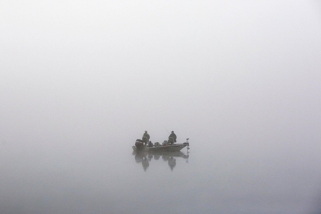 . Men fish in the dense, early-morning fog on Cheshire Lake in Cheshire, Mass., Friday, May 20, 2016. (Stephanie Zollshan/The Berkshire Eagle via AP)