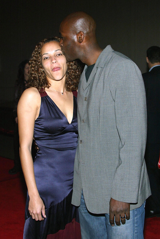 ". Actor Michael Jace (R) and  April attend the third season premiere screening of ""The Shield\"" at the Zanuck Theater on March 8, 2004 in Los Angeles, California.   (Photo by Frederick M. Brown/Getty Images)"
