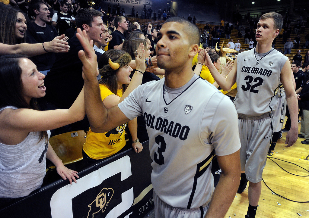 . BOULDER, CO. - MARCH 7: Buffs guard Xavier Dalton (3) and center Ben Mills (32) slapped hands with fans following the win. The University of Colorado men\'s basketball team defeated Oregon 76-53 Thursday night, March 7, 2013 at the CU Events Center in Boulder. (Photo By Karl Gehring/The Denver Post)