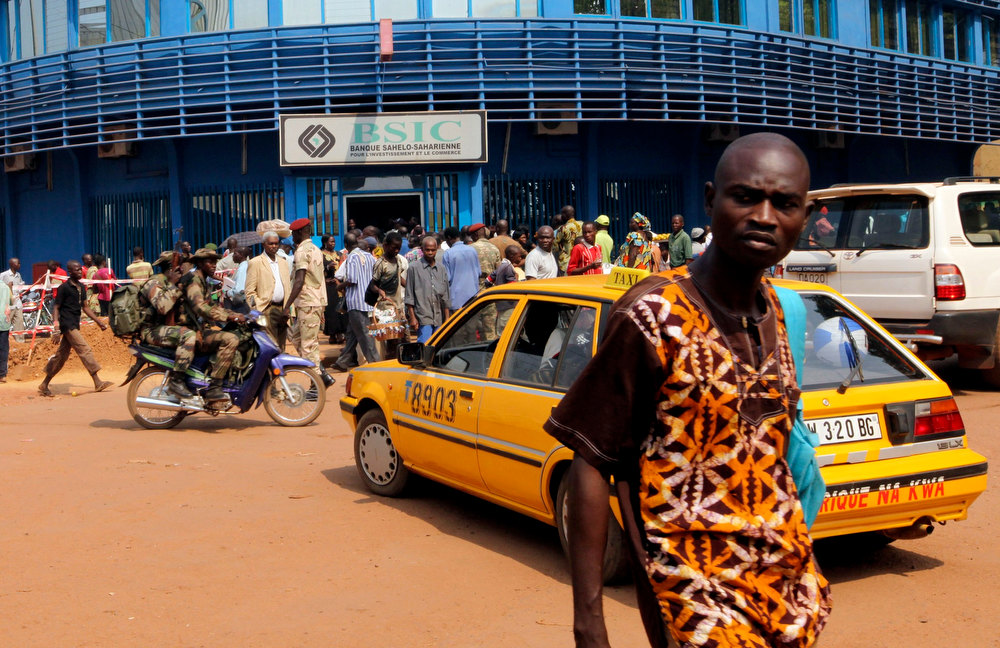 . Central African Republic soldiers ride past on a motorcycle on a street in Bangui December 31, 2012. Central African Republic\'s embattled President Francois Bozize said on Sunday he was ready to share power with the leaders of a rebellion that has swept aside government defences to within striking distance of the capital Bangui. REUTERS/Luc Gnago