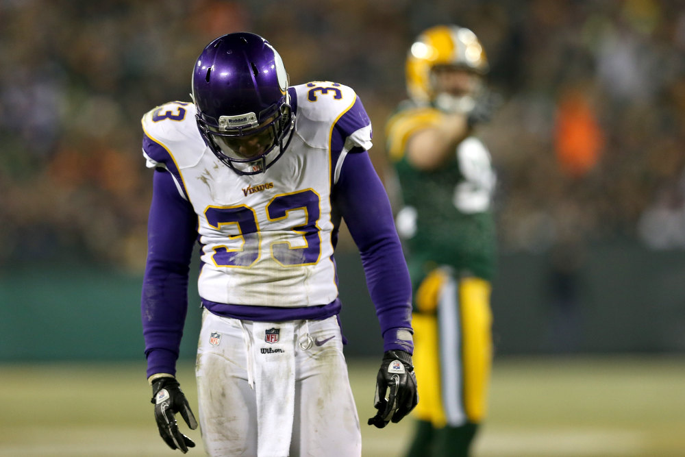 Description of . Strong safety Jamarca Sanford #33 of the Minnesota Vikings reacts in the third quarter against the Green Bay Packers during the NFC Wild Card Playoff game at Lambeau Field on January 5, 2013 in Green Bay, Wisconsin.  (Photo by Jonathan Daniel/Getty Images)