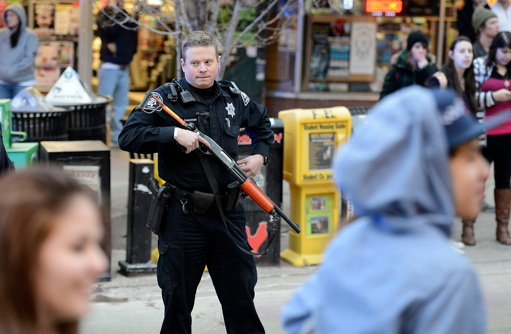 . A Boulder County Sheriff\'s deputy stands guard with a non-lethal shotgun during a disturbance at the The Fox Theater on Monday, March 11, in Boulder. Boulder Police responded with riot gear to keep the fans of the band Tyler the Creator under control.  Jeremy Papasso/Boulder Daily Camera