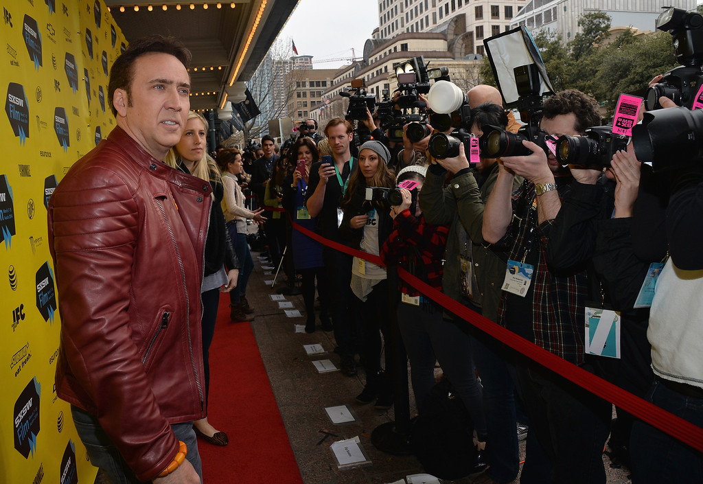 """. Actor Nicholas Cage arrives at the premiere of \""""Joe\"""" during the 2014 SXSW Music, Film + Interactive Festival at Paramount Theatre on March 9, 2014 in Austin, Texas.  (Photo by Michael Buckner/Getty Images for SXSW)"""