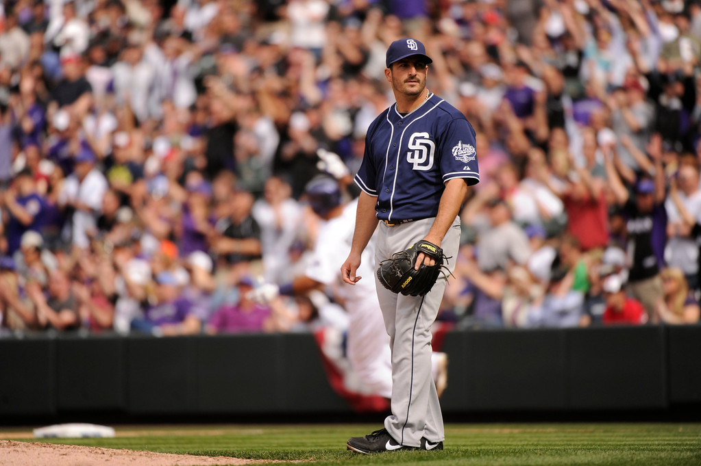 . Jason Marquis (21) of the San Diego Padres watches as Wilin Rosario (20) of the Colorado Rockies rounds the bases after hitting a home run in the fourth inning. (Photo by Karl Gehring/The Denver Post)