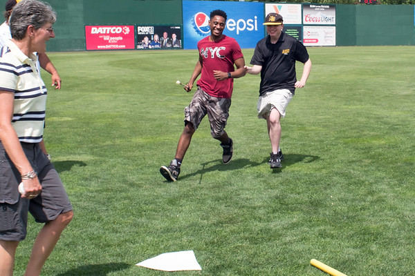 07/02/19 Wesley Bunnell | Staff The New Britain Bees welcomed group home members to New Britain Stadium as part of the Beautiful Lives Project on Tuesday July 2, 2019.Bees players and coaches played wiffle ball games on the outfield grass with the participants. Bryce Weiler, R, who's is legally blind. receives assistance scoring a run as Journey Found Director Sharon Alaconis, L, looks on.