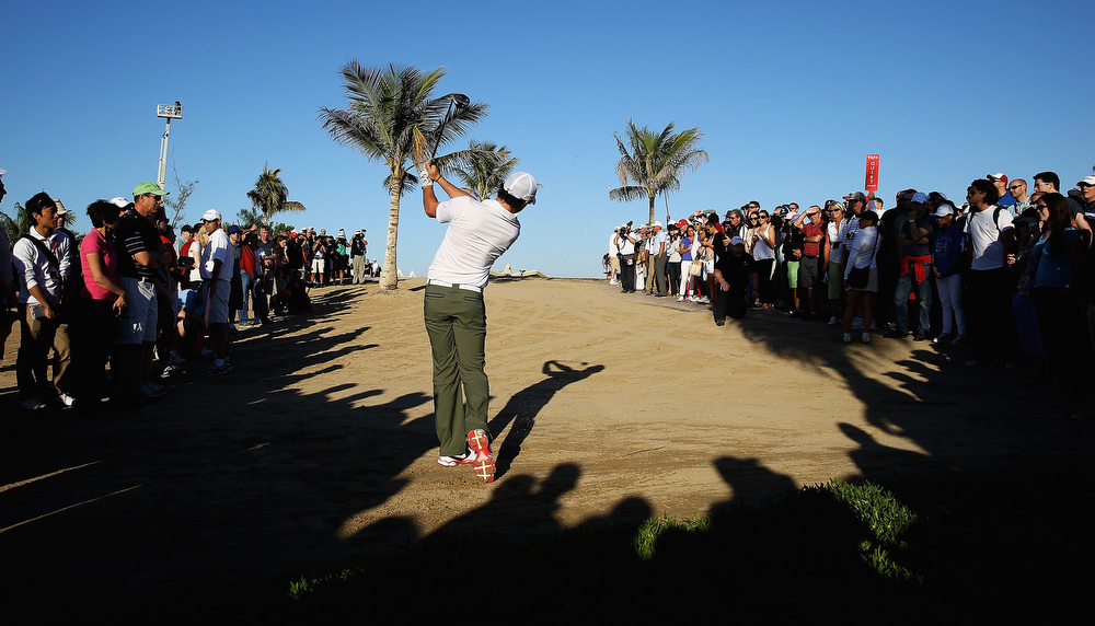 Description of . Rory McIlory of Northern Ireland plays out of the rough on the 18th hole during day two of the Abu Dhabi HSBC Golf Championship at Abu Dhabi Golf Club on January 18, 2013 in Abu Dhabi, United Arab Emirates.  (Photo by Matthew Lewis/Getty Images)