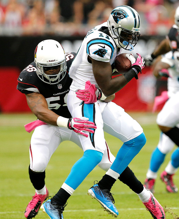 . Carolina Panthers wide receiver Brandon LaFell (11) is tackled by Arizona Cardinals linebacker Daryl Washington (58) during the first half of a NFL football game, Sunday, Oct. 6, 2013, in Glendale, Ariz. (AP Photo/Matt York)