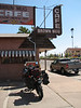 Breakfast on the corner in Winslow Arizona.<br /> <br /> <br /> Just west of the crater / Meteor crater road (Dirt)  heads south s towards Chavez Mtns   I just started down the road a   few miles  when two riders on ( XR650R) coming the other way stopped me    <br /> and told me the road was closed at where in went into the Sitgreaves natl. forest. it crossed a wash / river and the bridge was out and it was a real nasty crossing with real steep banks .  <br /> I then headed 15 miles east and had some breakfast on the corner in Winslow . I headed south then picked up rt 99 towards Heber  it was paved for around 25 miles then turnd into a two track rocky bumpy rutted road for about 15miles then into the natl. forest roads i was heading towards Chevlon Crossing.  I stopped at the camp ground to use the faclites . I have seen  no one since I was outside Winslow or on any of the roads.  The camp grounds were empty. nice very nice, The road out torwards Heber was fast and dusty but real good scenery.
