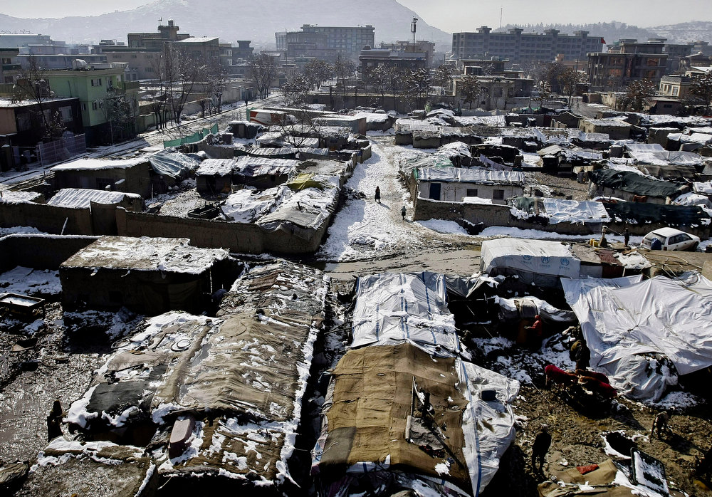 . General view of the refugee camp in Kabul, Afghanistan, Tuesday, Dec. 18, 2012. A German run charity organization, known as Johanniter, distributed winter relief assistance to some 279 internally displaced families in Kabul. (AP Photo/Musadeq Sadeq)