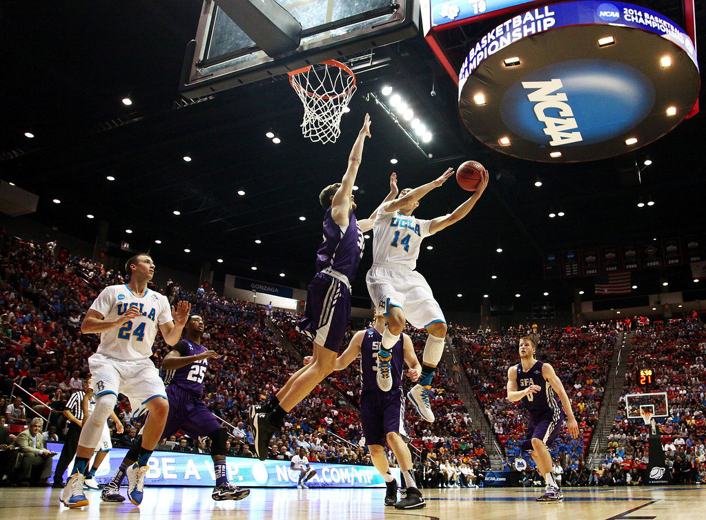 . Zach LaVine #14 of the UCLA Bruins goes up against Tanner Clayton #30 of the Stephen F. Austin Lumberjacks in the first half during the third round of the 2014 NCAA Men\'s Basketball Tournament at Viejas Arena on March 23, 2014 in San Diego, California.  (Photo by Donald Miralle/Getty Images)