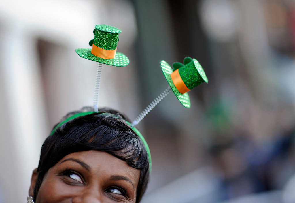 . Krystal Thomas of Atlanta parties on River Street while wearing a shamrock headband during the 189th St. Patrick\'s Day celebration, Friday, March 15, 2013, in Savannah, Ga. (AP Photo/Stephen Morton)
