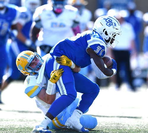 10/26/2019 Mike Orazzi | StaffrCCSU's Enyce Walker (31) and Long Island University's Dylan Cook (4) during Saturday's football game in New Britain.