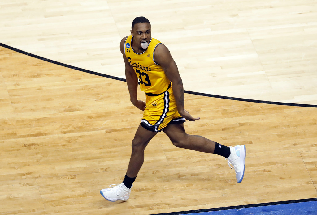 . UMBC\'s Arkel Lamar reacts after making a basket against Virginia during the second half of a first-round game in the NCAA men\'s college basketball tournament in Charlotte, N.C., Friday, March 16, 2018. (AP Photo/Chuck Burton)