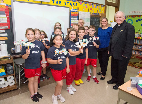 10/17/19 Wesley Bunnell | StaffrrMonsignor Daniel J. Plocharczyk, Pastor of Sacred Heart Church stands next to Principal of Sacred Heart School Kathy Muller as students in Mrs. Kerr's class at Sacred Heart School show their wind meters, or anemometer, they built as part of a class science project.