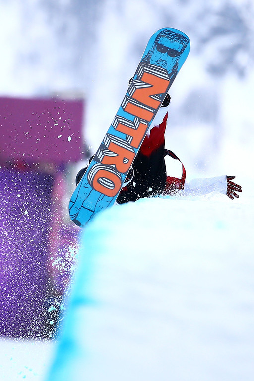 . Brad Martin of Canada competes in the Snowboard Men\'s Halfpipe Qualification Heats on day four of the Sochi 2014 Winter Olympics at Rosa Khutor Extreme Park on February 11, 2014 in Sochi, Russia.  (Photo by Al Bello/Getty Images)