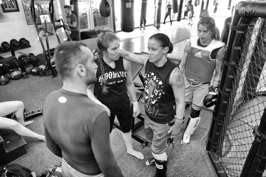 . Shayna Baszler , Marina Shafir and Jessamyn Duke talk with coach Edmond Tarverdyan at Glendale Fighting Club in Glendale. (Photo by Hans Gutknecht/Los Angeles Daily News)