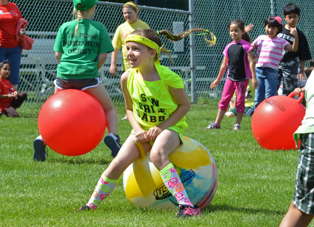 . Second grade student Gabby Gentile smiles during a hip hop race during  Olympics Day at Hatfield Elementary School.   Friday,  June 6, 2014.   Photo by Geoff Patton