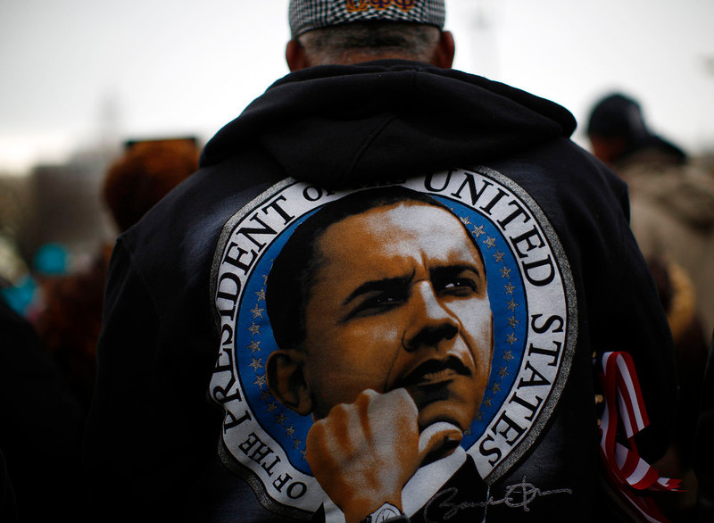 . A man wears a jacket on the National Mall during the 57th inauguration ceremonies for U.S. President Barack Obama and Vice President Joe Biden on the West front of the U.S. Capitol, in Washington January 21, 2013. REUTERS/Eric Thayer