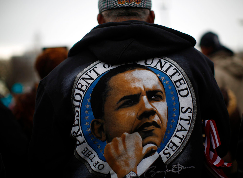 Description of . A man wears a jacket on the National Mall during the 57th inauguration ceremonies for U.S. President Barack Obama and Vice President Joe Biden on the West front of the U.S. Capitol, in Washington January 21, 2013. REUTERS/Eric Thayer