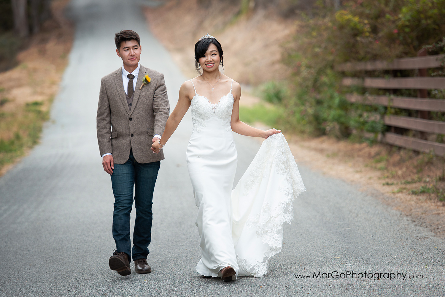 bride and groom walking holding hands at Long Branch Saloon & Farms in Half Moon Bay
