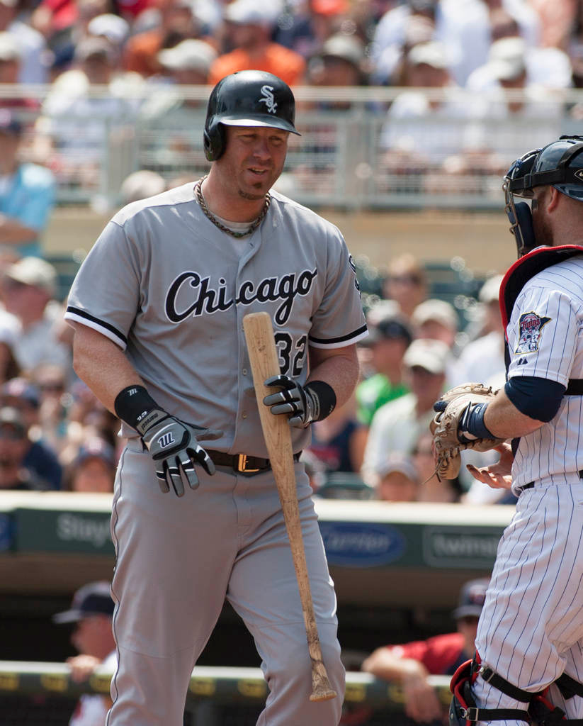 . Chicago White Sox\'s Adam Dunn heads back to the dugout after striking out in the first inning. Dunn was 0-4 on the day ending a nine-game hitting streak.(AP Photo/Paul Battaglia)