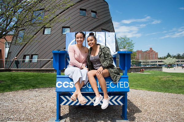 05/6/19 Wesley Bunnell | Staff CCSU's Africana Center held the Essence Festival on Tuesday afternoon to bring together the community as a whole and support empowerment and understanding amongst groups. The day featured vendors, food and music for anyone to participate. Freshmen Jazzmarie Torres, L, and Chasity Sanchez, sit on an oversized chair while enjoying lunch.