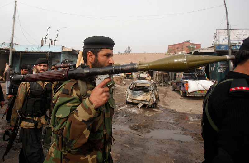 . A paramilitary soldier holds a rocket-propelled grenade (RPG) at the site of a bomb attack at Fauji Market in Peshawar December 17, 2012. At least 12 people were killed on Monday when the blast struck the market area in Pakistan\'s volatile tribal belt, a security official said. The official said at least 20 people had been wounded in the blast in Fauji Market in the Khyber tribal agency and that the death toll could rise because many were in a critical condition. There was no immediate claim of responsibility. REUTERS/Fayaz Aziz