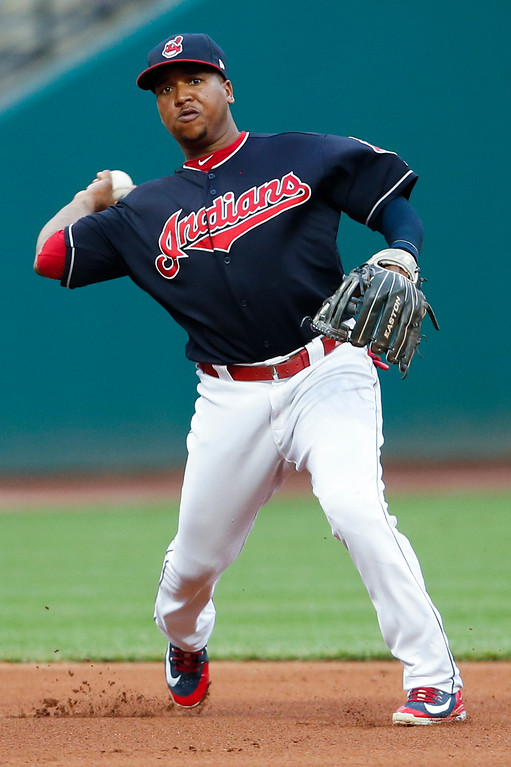 . Cleveland Indians\' Jose Ramirez throws out New York Yankees\' Austin Romine at first base during the fourth inning of a baseball game, Saturday, July 14, 2018, in Cleveland. (AP Photo/Ron Schwane)