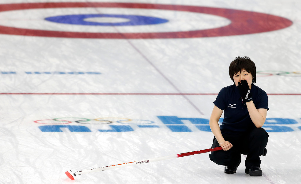 . Japan\'s Michiko Tomabechi watches the stone during the women\'s curling match against Switzerland at the 2014 Winter Olympics, Sunday, Feb. 16, 2014, in Sochi, Russia. (AP Photo/Wong Maye-E)
