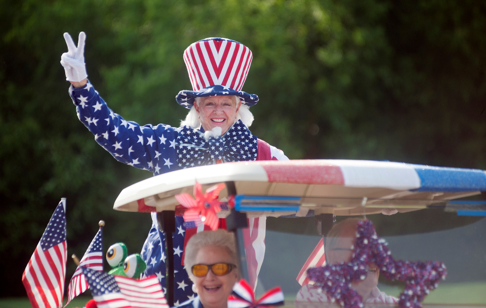 Description of . People participated during the annual Golf Cart Parade at Meadow Lake Senior Living Community in Tyler, Texas, Friday, July 4, 2014. (AP Photo/The Tyler Morning Telegraph, Sarah A. Miller)