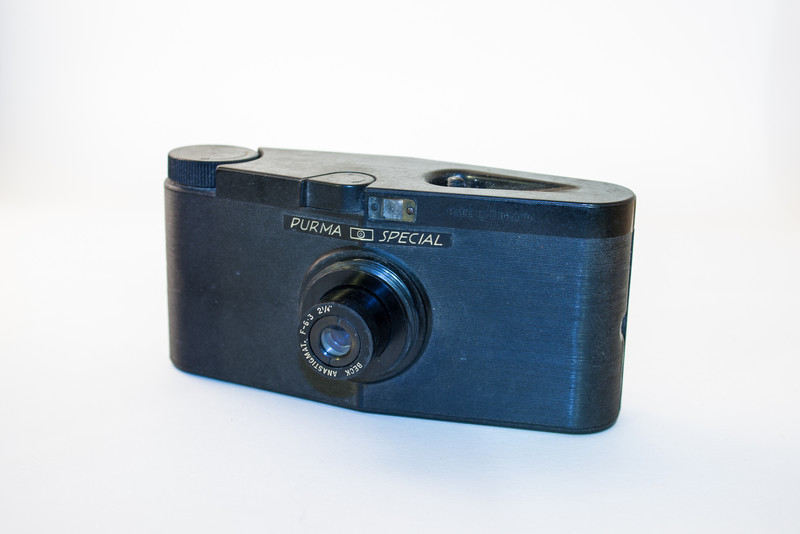 Purma Special The Purma Special was introduced in 1937 and manufactured until 1951. This was a particularly unusual-looking bakelite camera, featuring a unique shutter and lens mechanism. The lens was spring loaded, being pushed back into the camera when the lens cap was replaced; preventing the photographer from making an exposure whilst the cap was on. The Purma Special takes 16 1.25 inch square photos on a 127mm film. Two red windows on the rear of the camera are used to align the frame when advancing the film.