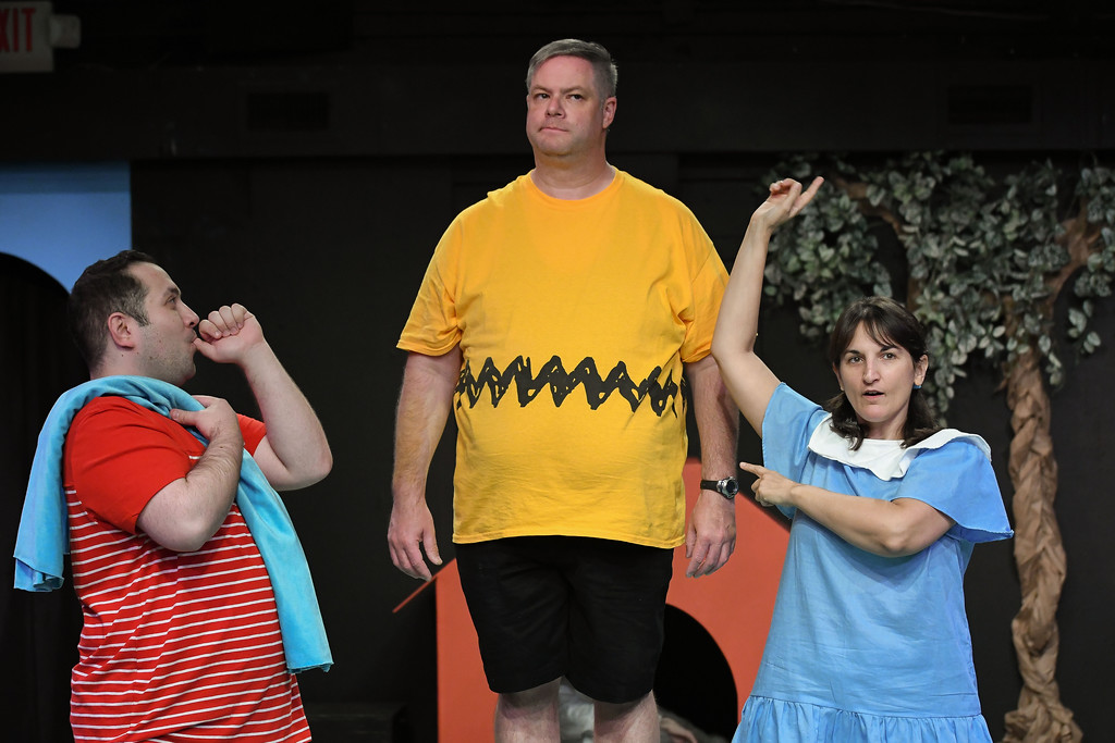 ". Performers for Amherst\'s Workshop Players Theater rehearse a scene from ""You\'re a Good Man, Charlie Brown.\"" Pictured, from left, are: Matt Cuffari, 31, of Lorain as Linus; Kevin Cline, 43, of North Ridgeville as Charlie Brown and Alicia Fogal, 45, of Rocky River as Lucy. The show continues through Oct. 1. For more information, visit workshopplayers.com. (Eric Bonzar�The Morning Journal)"