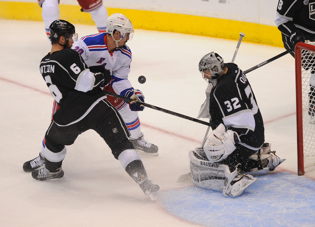 . The Rangers\' Chris Kreider battles the Kings\' Jake Muzzin for the puck in front of goalie Jonathan Quick in game two of the Stanley Cup Final, Saturday, June 7, 2014, at Staples Center. (Photo by Michael Owen Baker/Los Angeles Daily News)