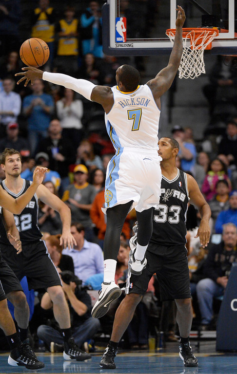 . Denver Nuggets power forward J.J. Hickson (7) goes up for a rebound as San Antonio Spurs power forward Boris Diaw (33) looks on during the first quarter October 14, 2013 at Pepsi Center. (Photo By John Leyba/The Denver Post)