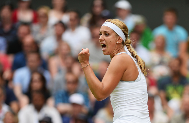 . Sabine Lisicki of Germany celebrates a point during her Ladies\' Singles fourth round match against Serena Williams of United States of America on day seven of the Wimbledon Lawn Tennis Championships at the All England Lawn Tennis and Croquet Club on July 1, 2013 in London, England.  (Photo by Mike Hewitt/Getty Images)
