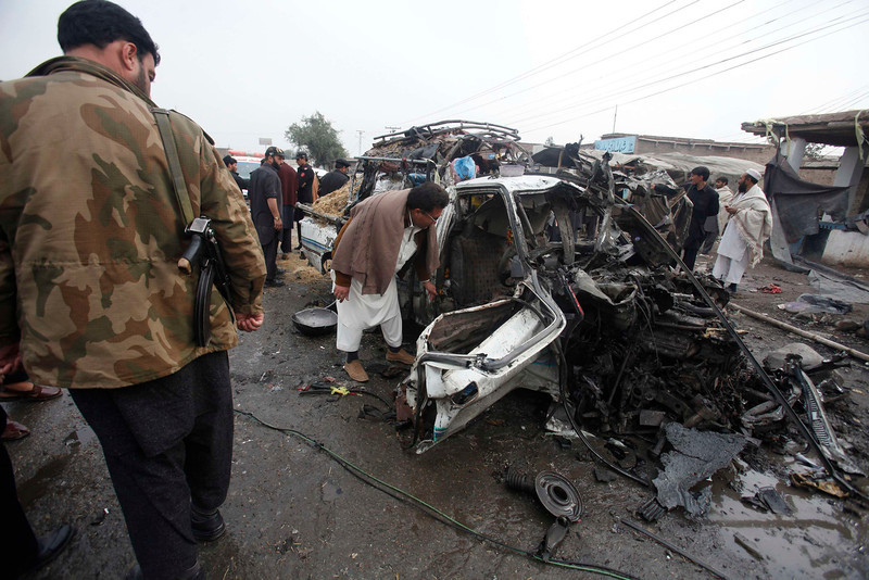 . A man looks into a car, which was damaged during a bomb attack at Fauji Market in Peshawar December 17, 2012. The blast in the market in northwest Pakistan on Monday killed at least 15 people, a security official said. The official said at least 20 people had been wounded in the blast in the market in the Khyber region, near the border with Afghanistan, and the death toll could rise. REUTERS/Fayaz Aziz