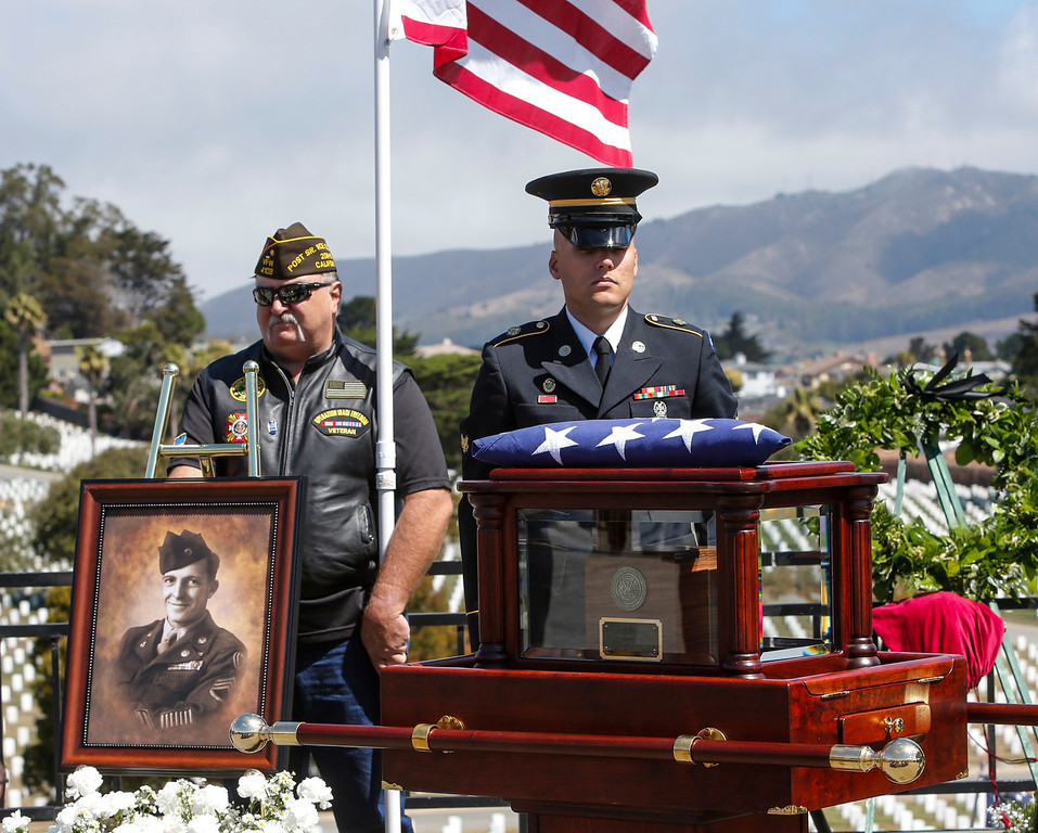 . A member of the color guard stands behind the urn vault with the remains Sgt. 1st Class Joseph Steinberg at Golden Gate National Cemetery in San Bruno, Calif., on Aug. 1, 2013. (John Green/Bay Area News Group)