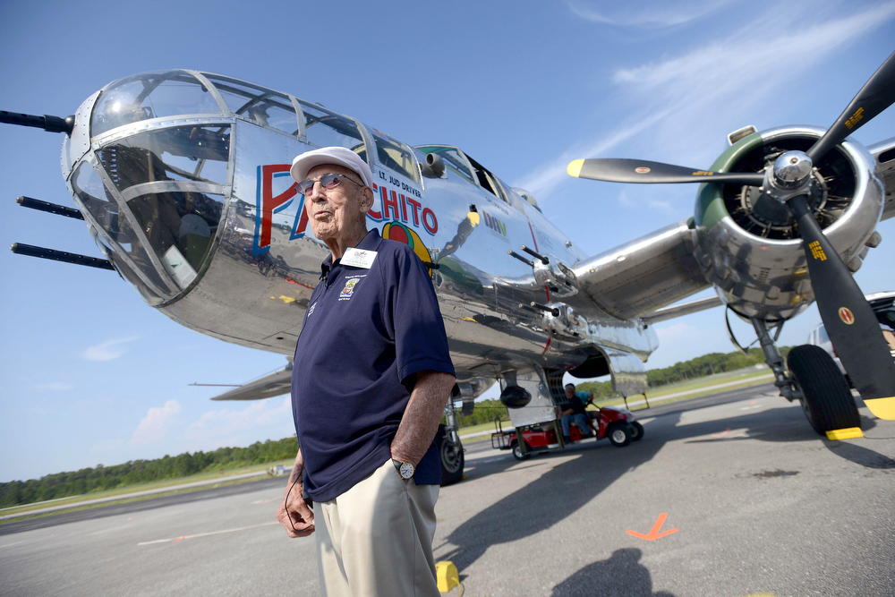 . Doolittle Raider Lt. Col. Dick Cole, stands in front of a B-25 at the Destin Airport in Destin, Fla.  on Tuesday April 16, 2013 before a flight as part of the Doolittle Raider 71st Anniversary Reunion. Cole was Lt. Col. Jimmy Doolittle\'s co-pilot during the raid. The Doolittle Tokyo Raid was a notable attack on the Japanese during World War II using B-25\'s. The B-25 pilots trained to take off from an aircraft carrier, which the plane was not designed to do. (AP Photo/Northwest Florida Daily News, Nick Tomecek)