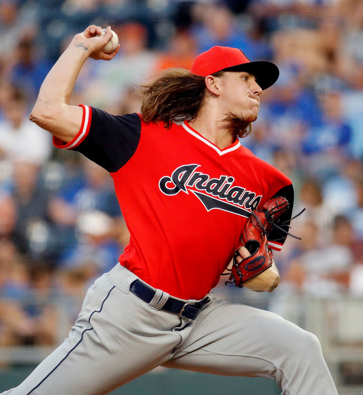 . Cleveland Indians starting pitcher Mike Clevinger throws during the first inning of a baseball game against the Kansas City Royals on Friday, Aug. 24, 2018, in Kansas City, Mo. (AP Photo/Charlie Riedel)
