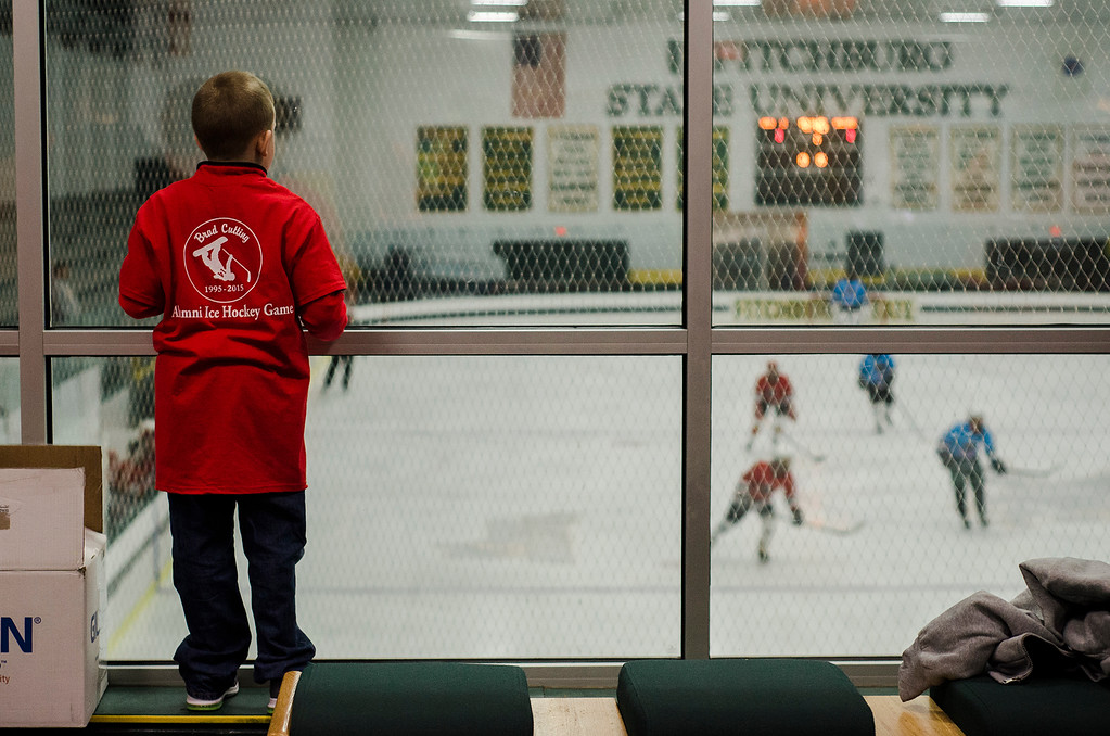 . Zebadiah Conley, 7, watches the action during the 2nd Annual Brad Cutting Memorial Ice Hockey Game at the Wallace Civic Center in Fitchburg on Saturday, March 25, 2017.  Cutting was just 20-years-old when he died in a two-car accident on November 27, 2015. SENTINEL & ENTERPRISE / Ashley Green