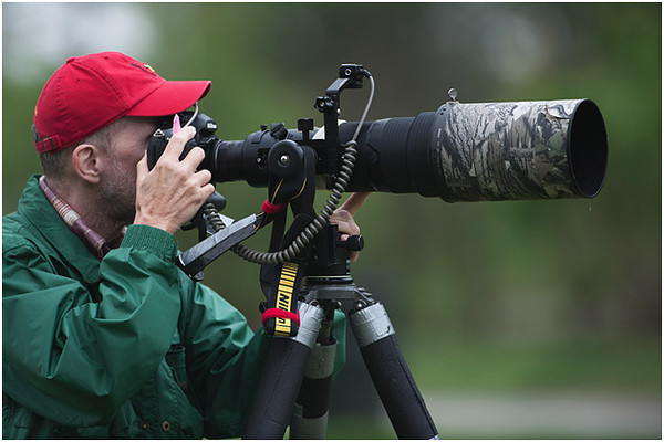 photographer with Nikon 500mm lens