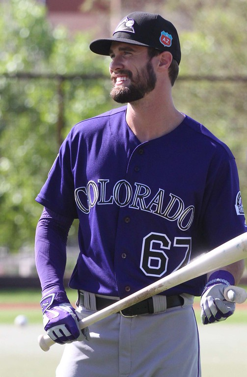 . David Dahl (67) goes through a bunting drill with the Colorado Rockies in Scottsdale, Ariz., March 1, 2016. (Shelly Bolt/Special to The Denver Post)