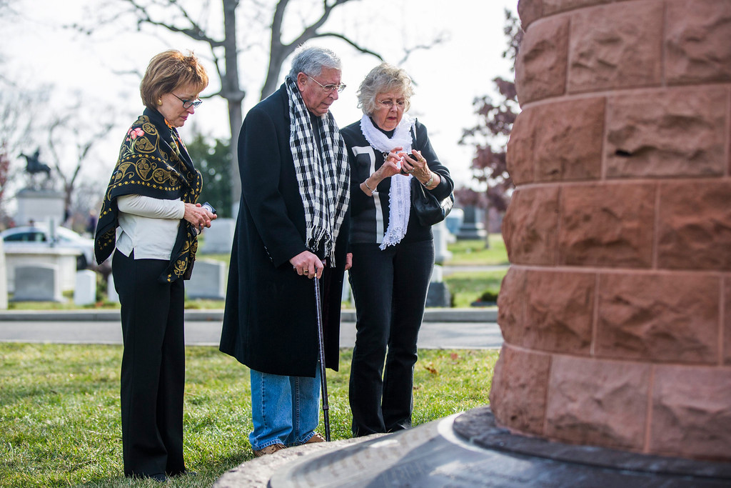 . Ted Reina (C), whose daughter was a flight attendant on Pan Am flight 103, which Libyan terrorists blew up over Lockerbie, Scotland, gathers at a memorial cairn with his friends Becky Sprecher (L) and Phyllis Cram (R), to honor his daughter\'s memory in Arlington National Cemetery on the 25th anniversary of the incident in Arlington, Virginia, USA, 21 December 2013. The terrorist act killed 243 passengers and 16 crew members, as well as 11 people on the ground.  EPA/JIM LO SCALZO