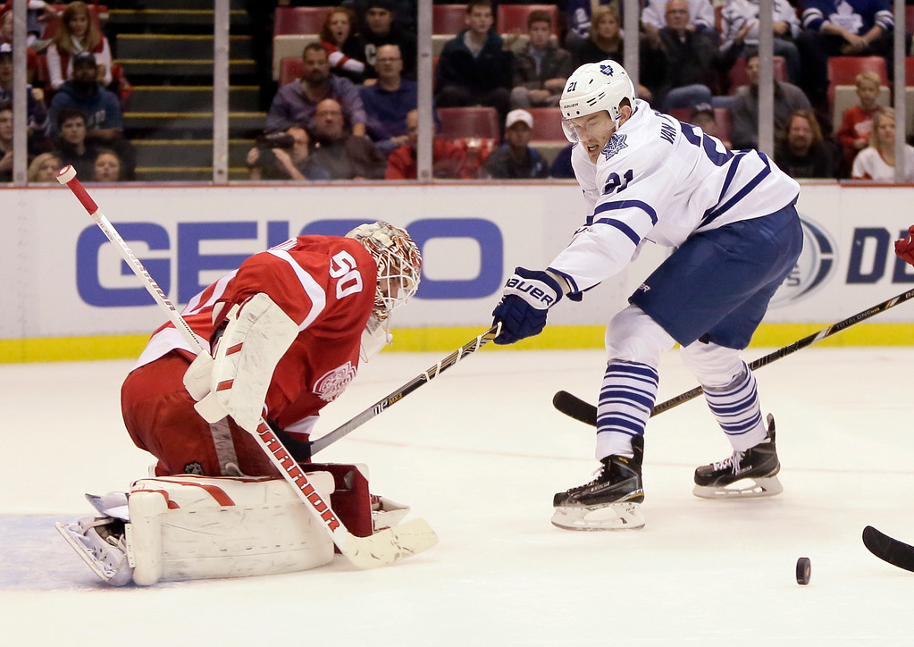 . Toronto Maple Leafs\' James van Riemsdyk has his shot deflected by Detroit Red Wings goalie Jonas Gustavsson (50), of Sweden, during the first period of an NHL hockey games Saturday, Oct. 18, 2014, in Detroit. (AP Photo/Duane Burleson)