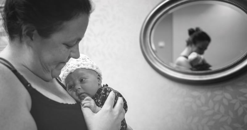 Baby V & mom by mirror.jpg