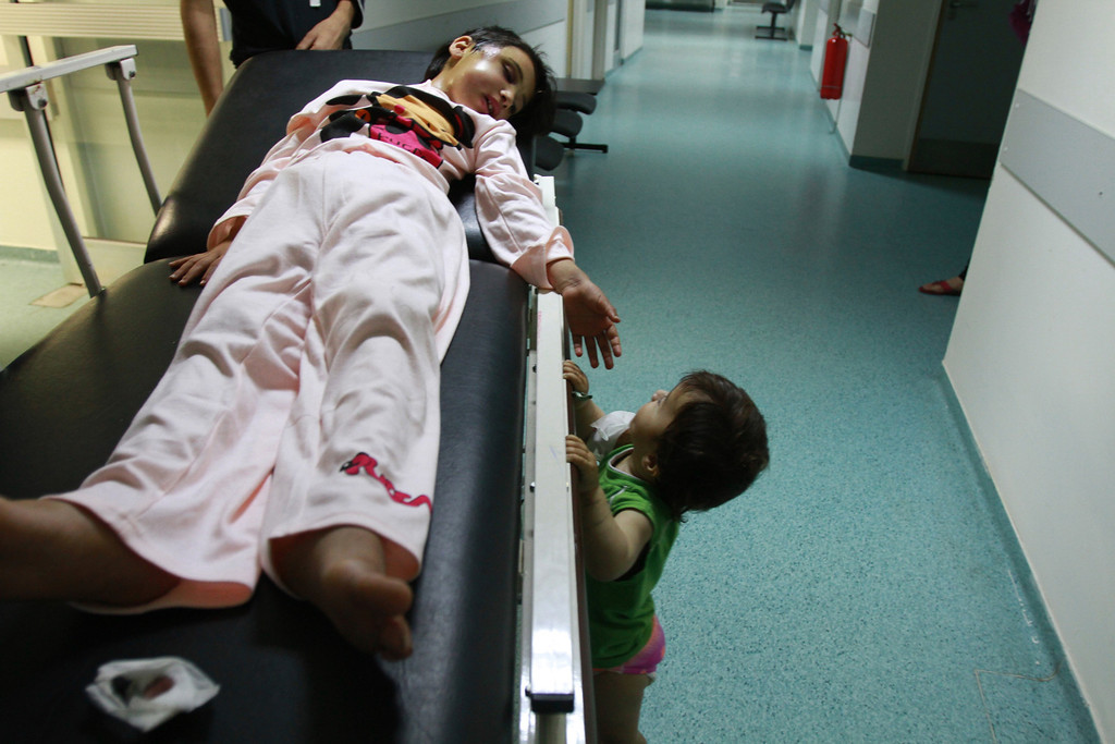 . Shams al-Mohamad, a 6-year-old Syrian girl, lies on a stretcher as she looks at her sister Marwa at a hospital in Tripoli, northern Lebanon, June 14, 2012. According to their mother, Shams and Marwa were wounded when a shell hit their house during fighting between Syrian troops and anti-government forces in the Syrian town of Qusair. REUTERS/Omar Ibrahim